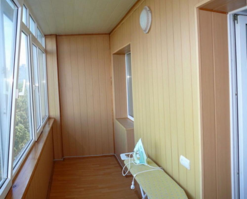 Пример отделки мдф панелями балкон.